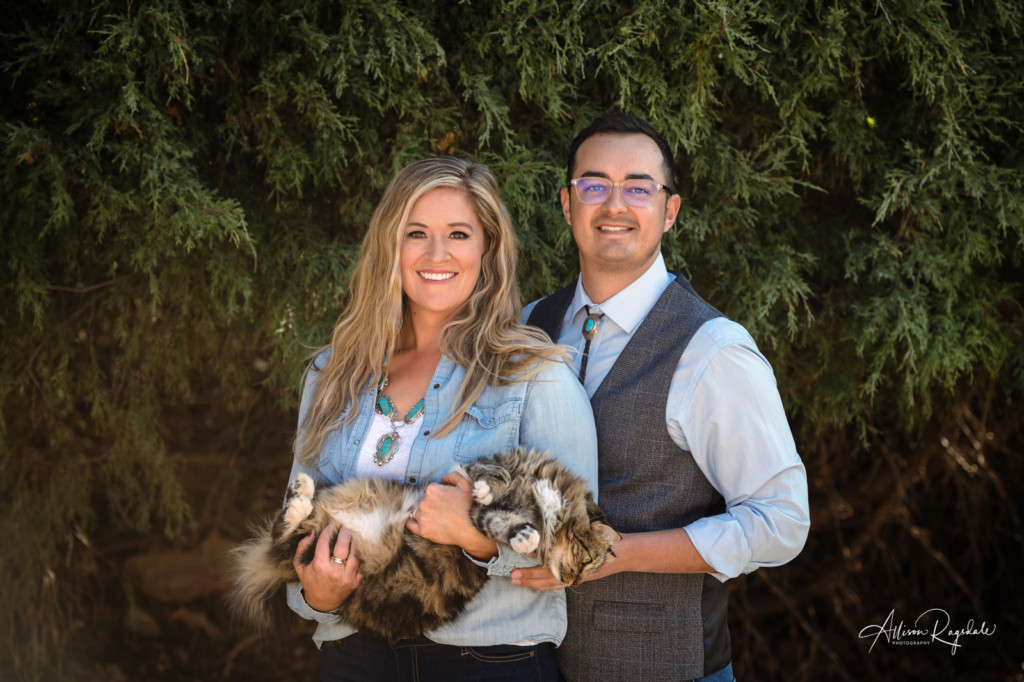 couple portraits in backyard with pet cat