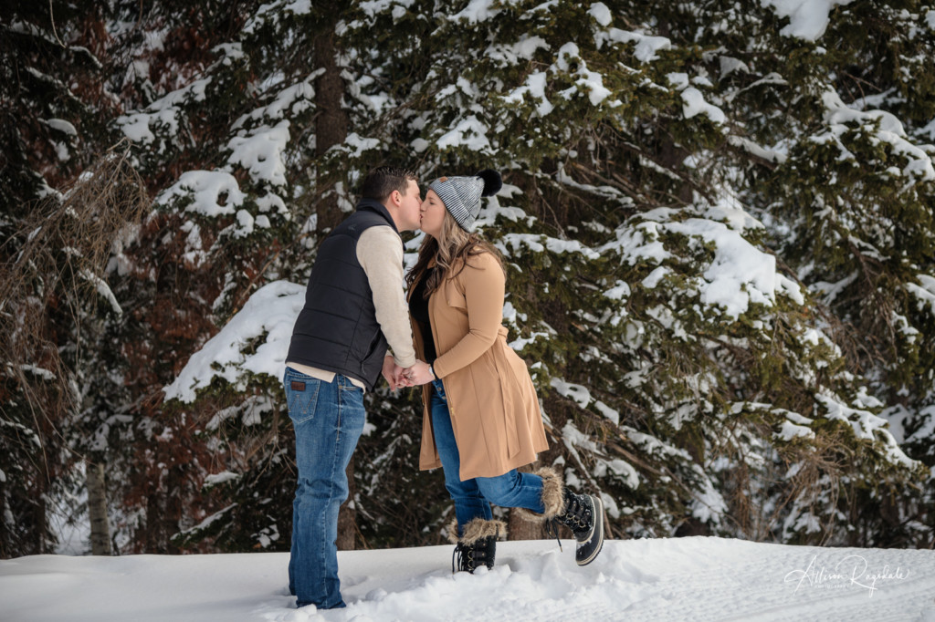 snowy pine trees engagement photo