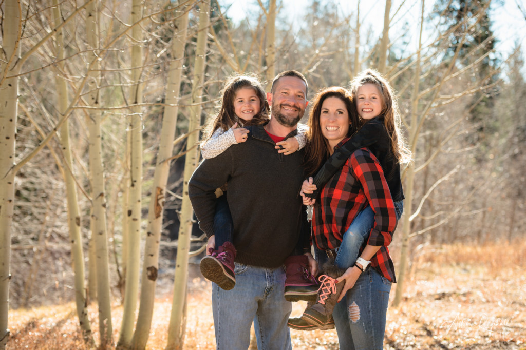 family picture colorado aspen trees background piggy back rides