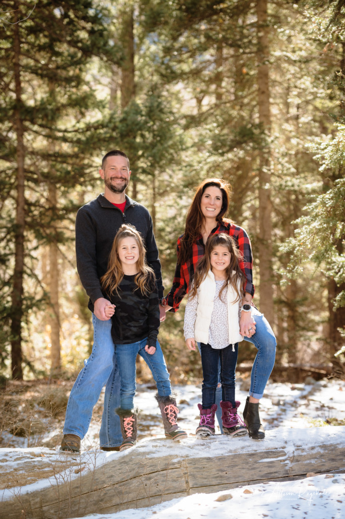 family pictures in pine trees with snow colorado