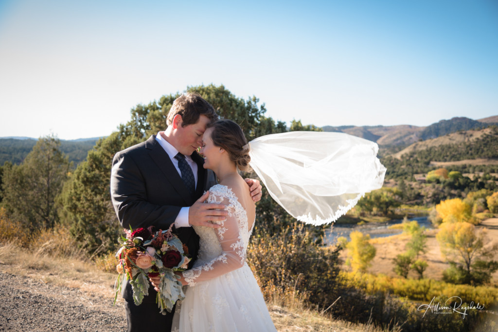 bride veil blowing in wind couple portrait with animas river in background