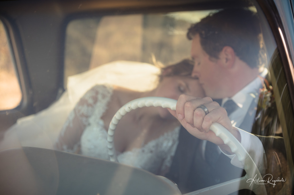 bride and groom wedding photo in old truck