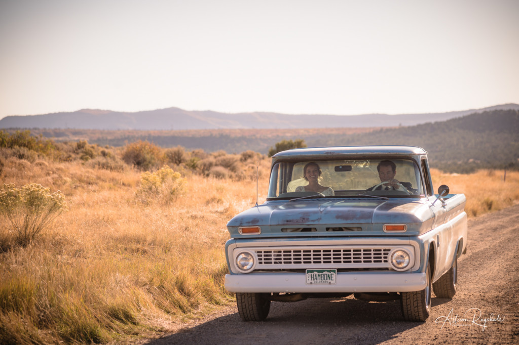 bride and groom driving vintage chevy wedding picture