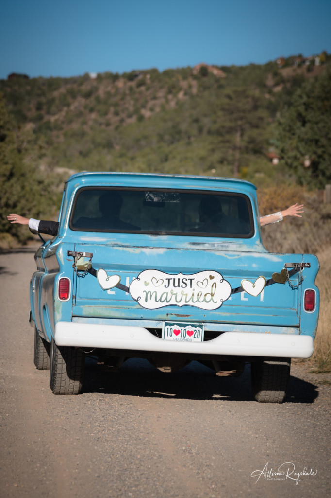 just married vintage Chevrolet bride and groom waving out windows picture