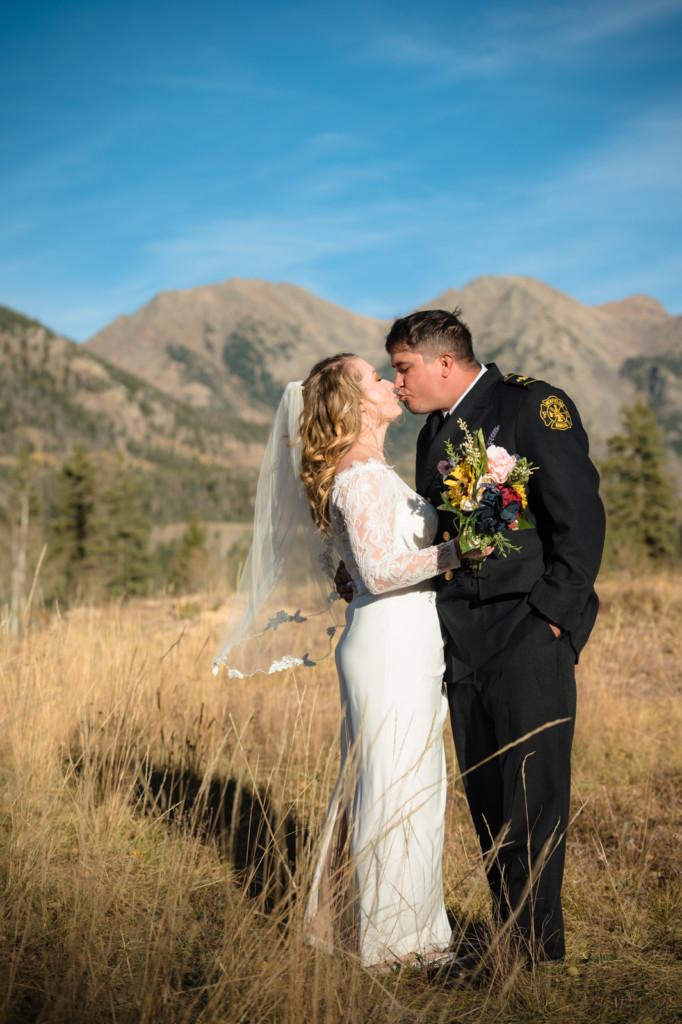 colorado mountains bride and groom kissing photo