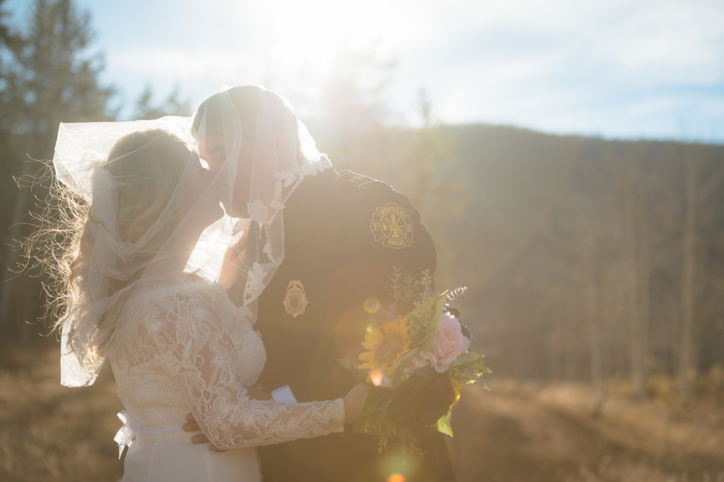 sunflare bride and groom under veil picture