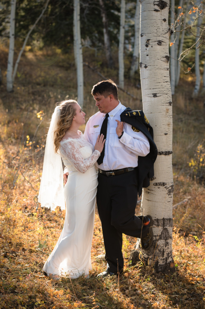 bride and groom in aspen trees elopement picture