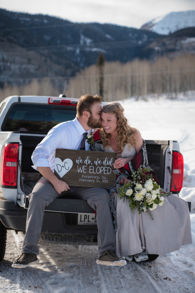 photo in back of truck elopement couple