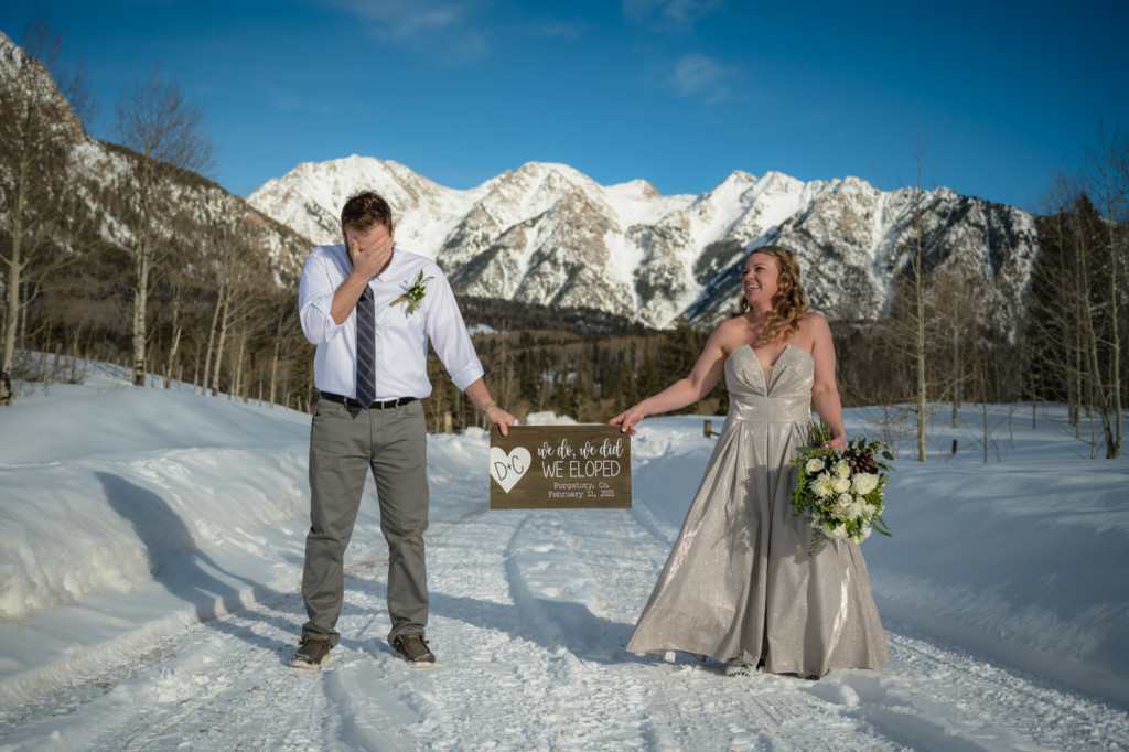 funny picture of bride and groom elopement colorado mountains