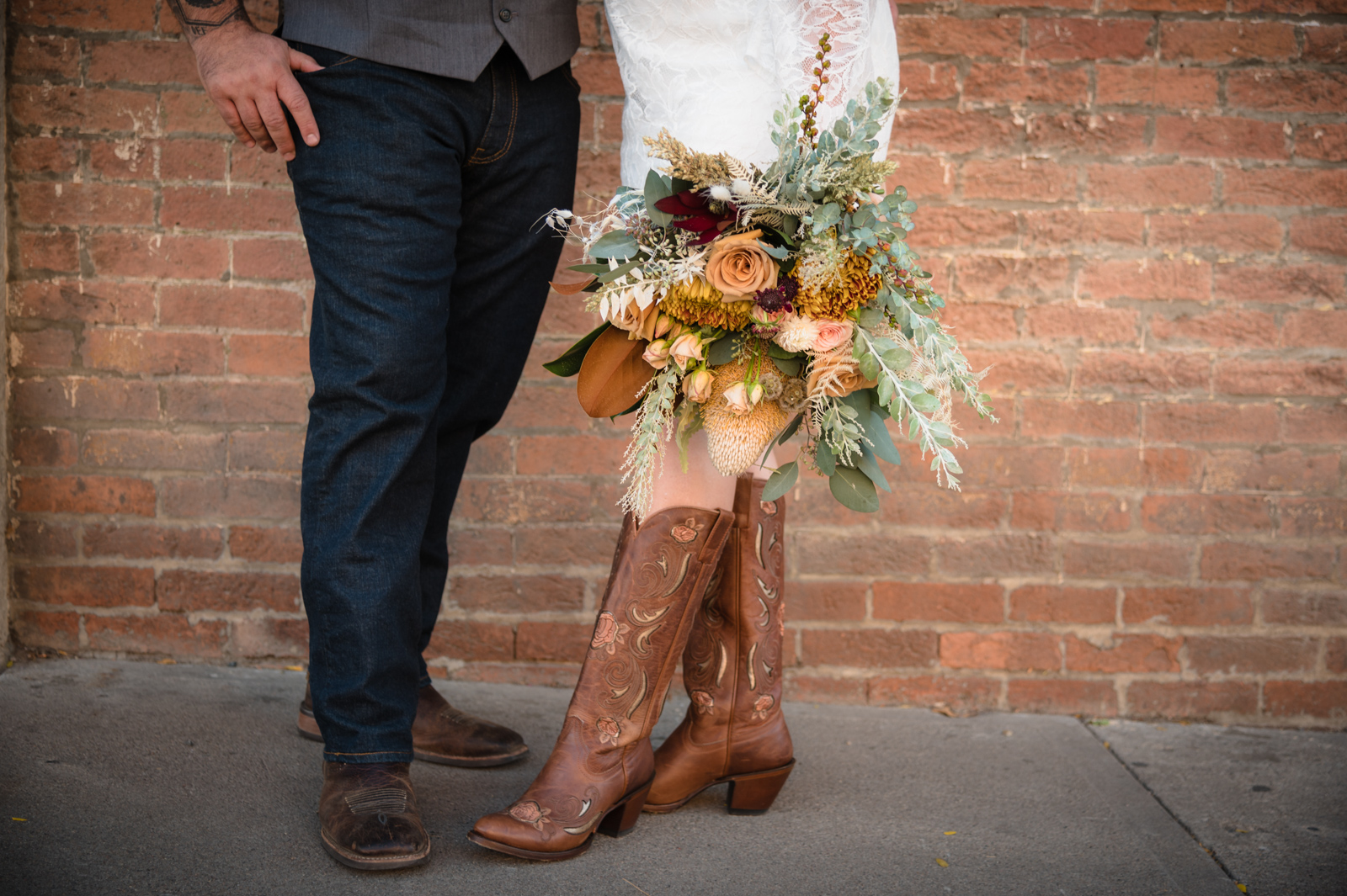 adela floral wedding bouquet with cowboy boots downtown durango photo
