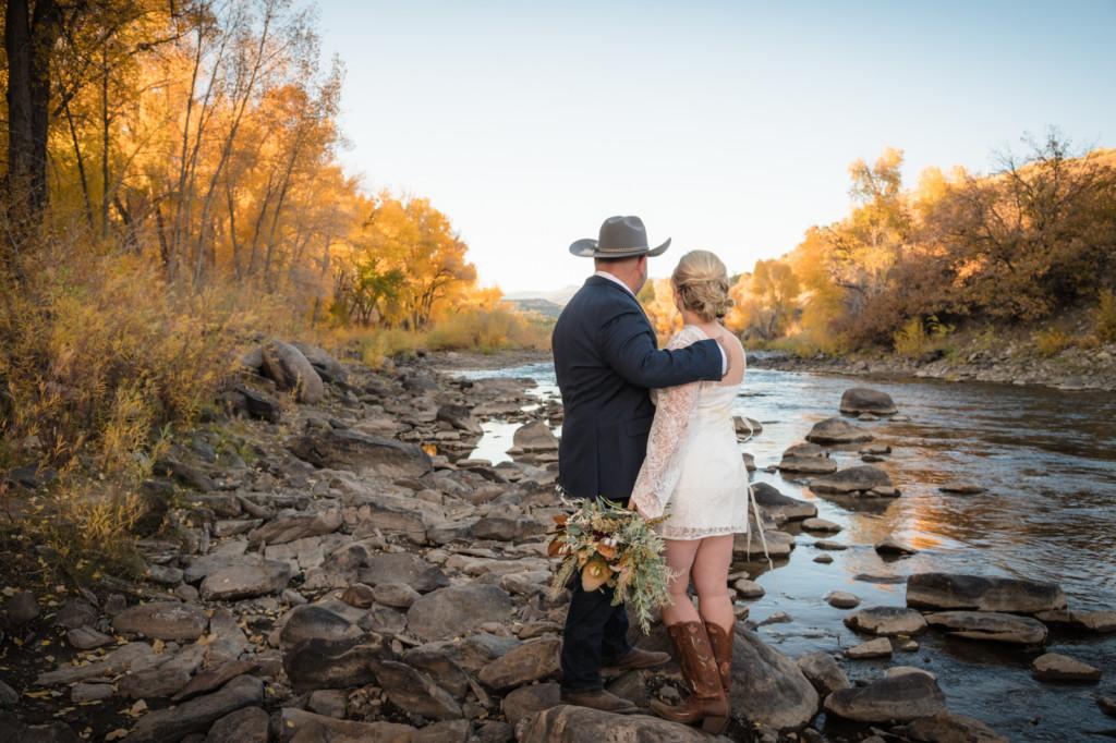 bride and groom looking at animas river durango fall season photo