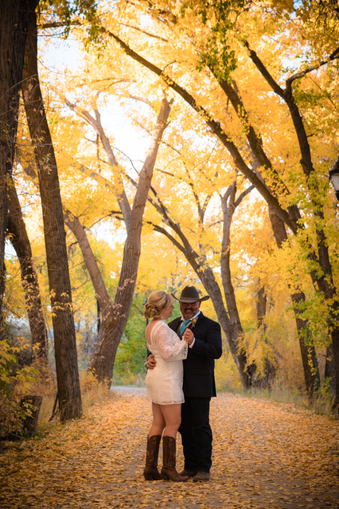 bride and groom dancing in fall leaves durango co picture