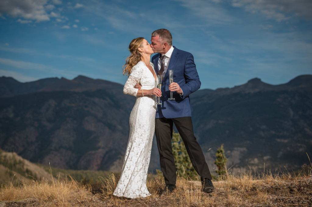 bride and groom champagne toast kiss portrait durango mountains