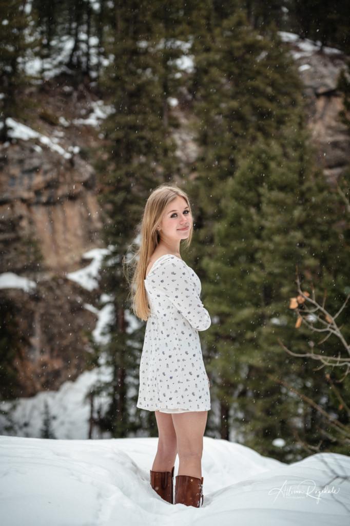 senior girl picture snowing in colorado
