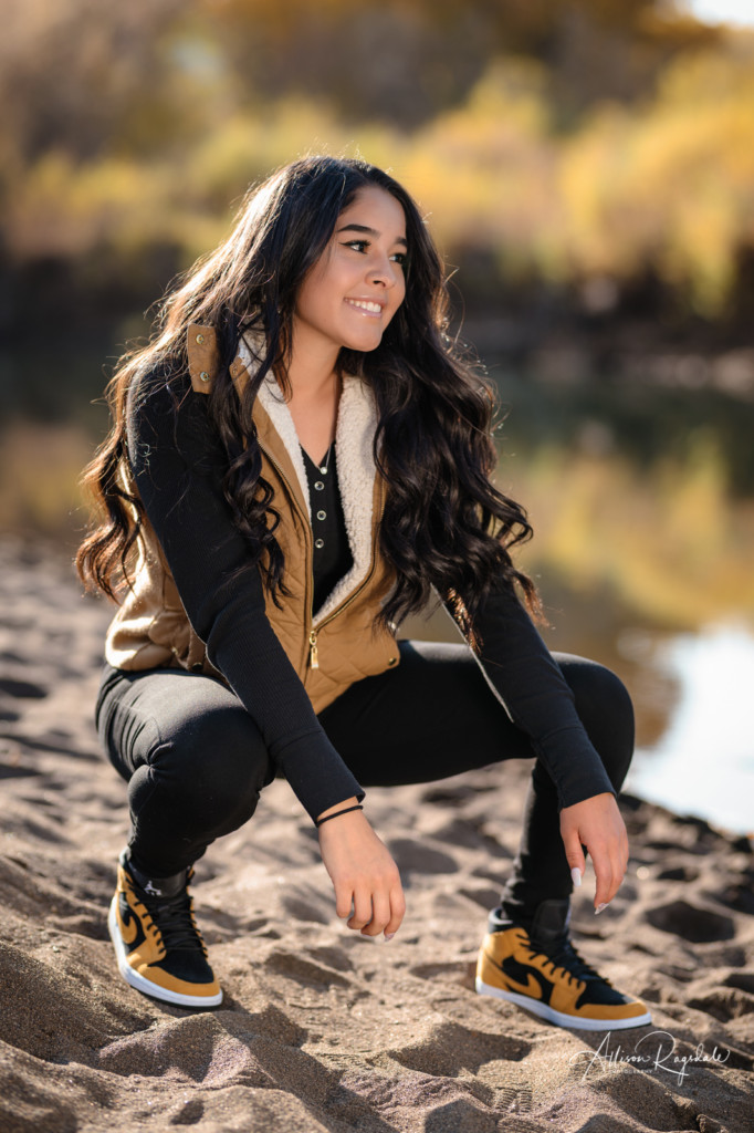 senior girl picture in nike by animas river on beach