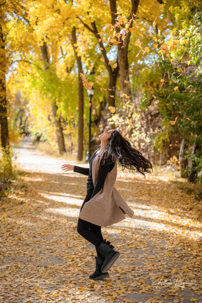 senior girl spinning in fall leaves durango co pic