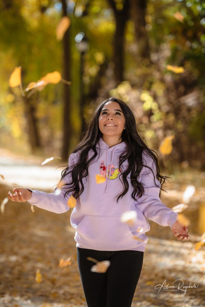 sponge bob sweatshirt throwing fall leaves senior girl photo