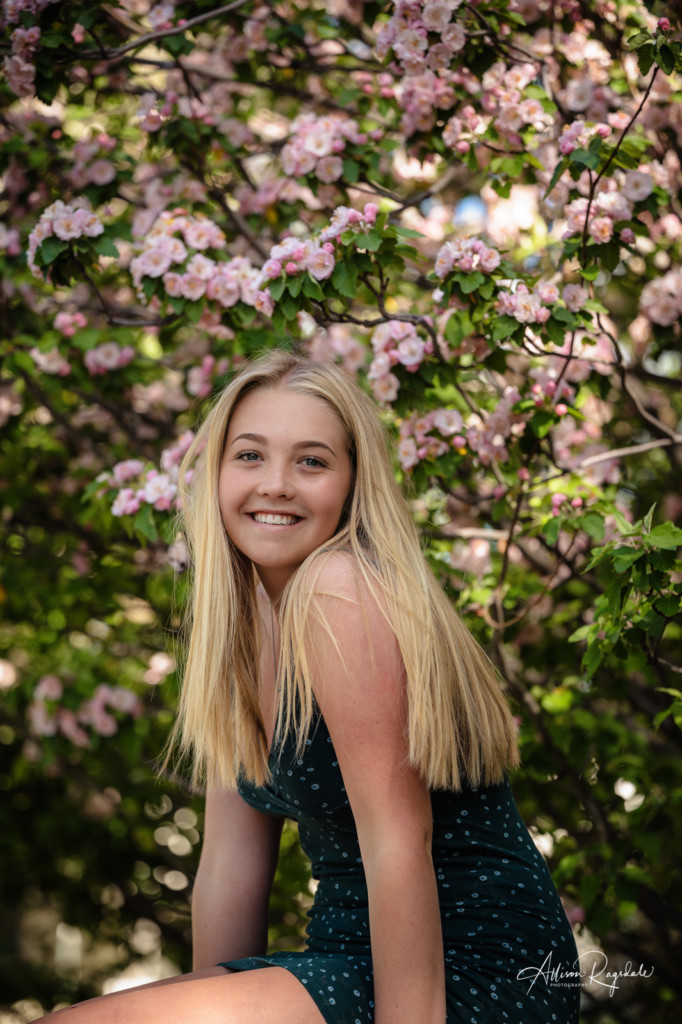class of 2022 senior girl photo with spring blossoms
