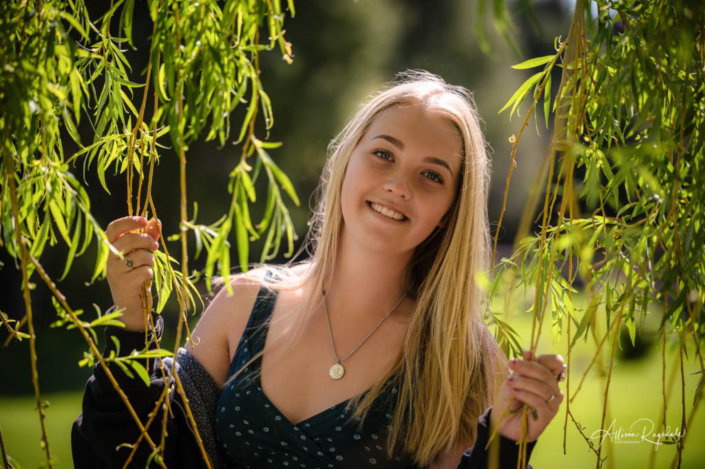 girl senior picture in willow tree