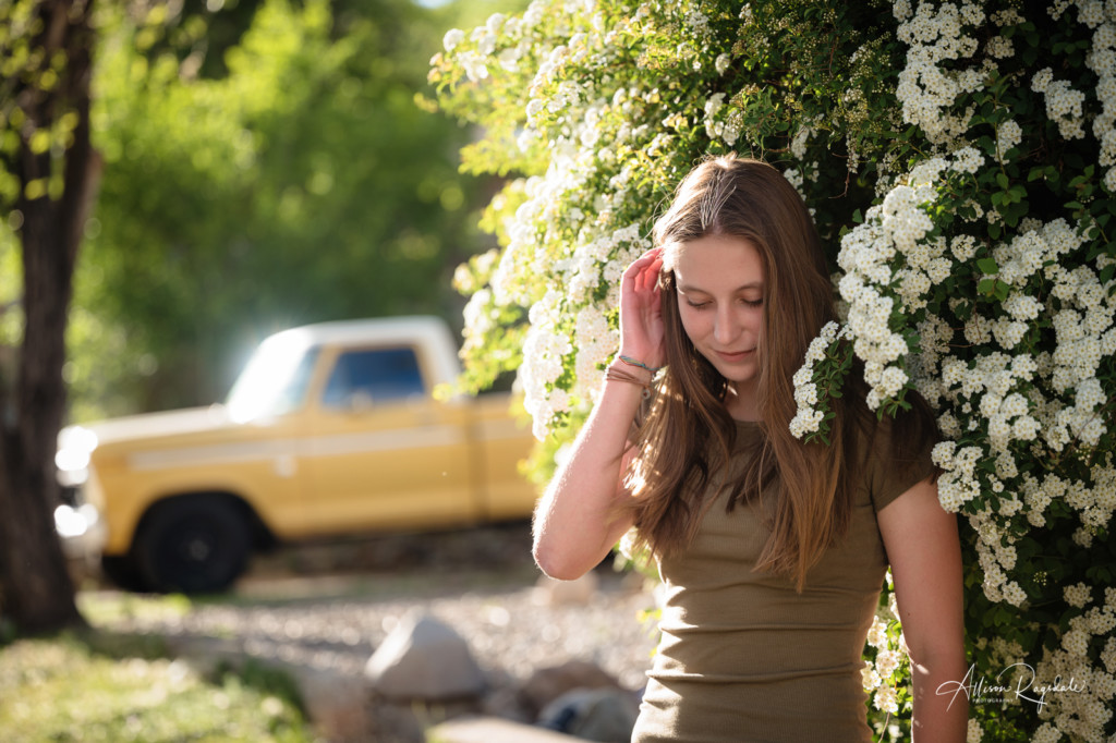 senior girl picture white spring blossoms yellow truck
