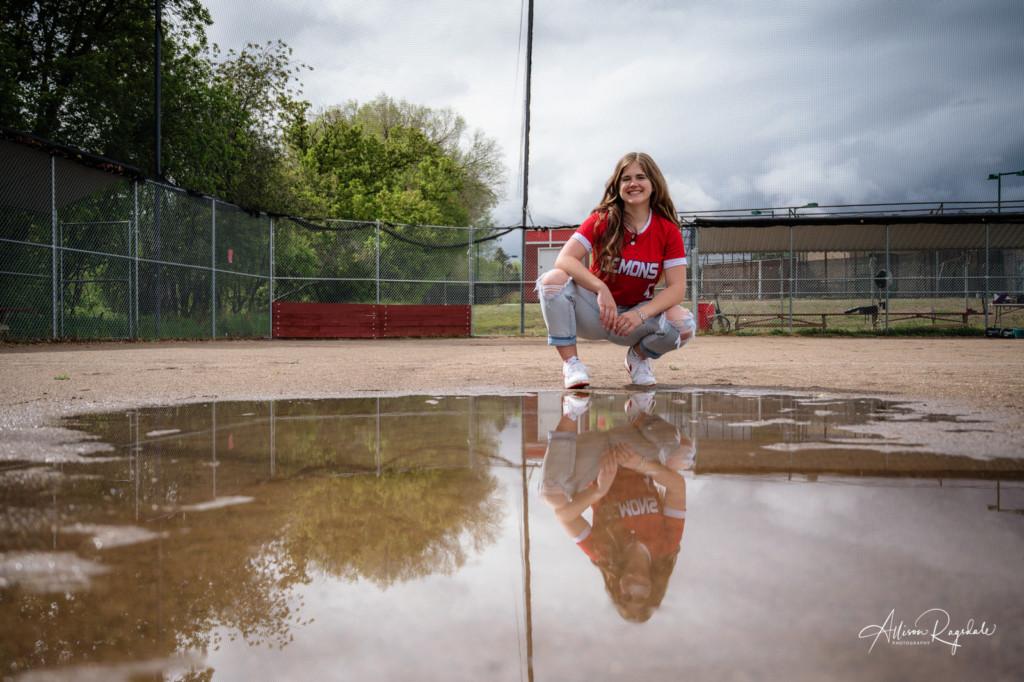 softball reflection in puddle senior girl photo