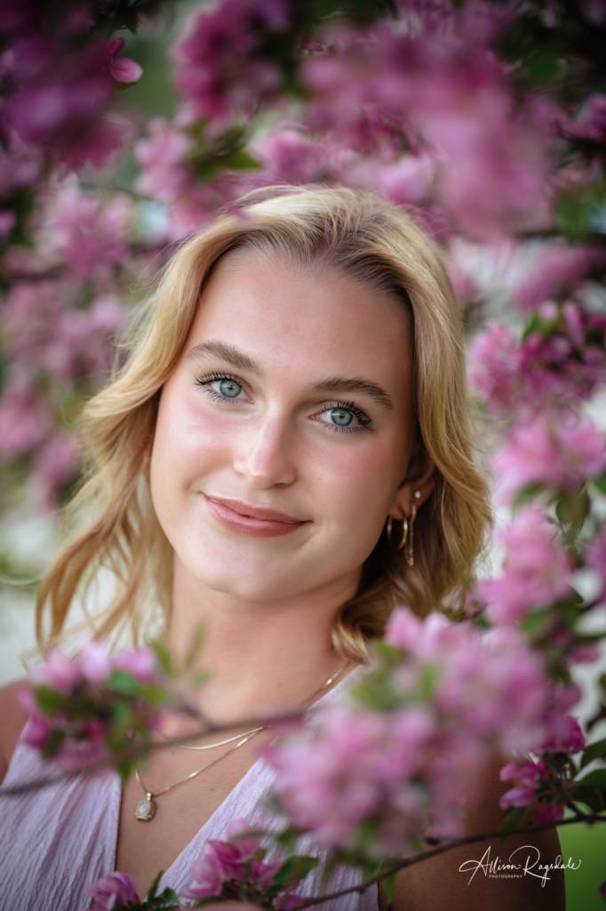 class of 2021 senior girl headshot in spring flowers