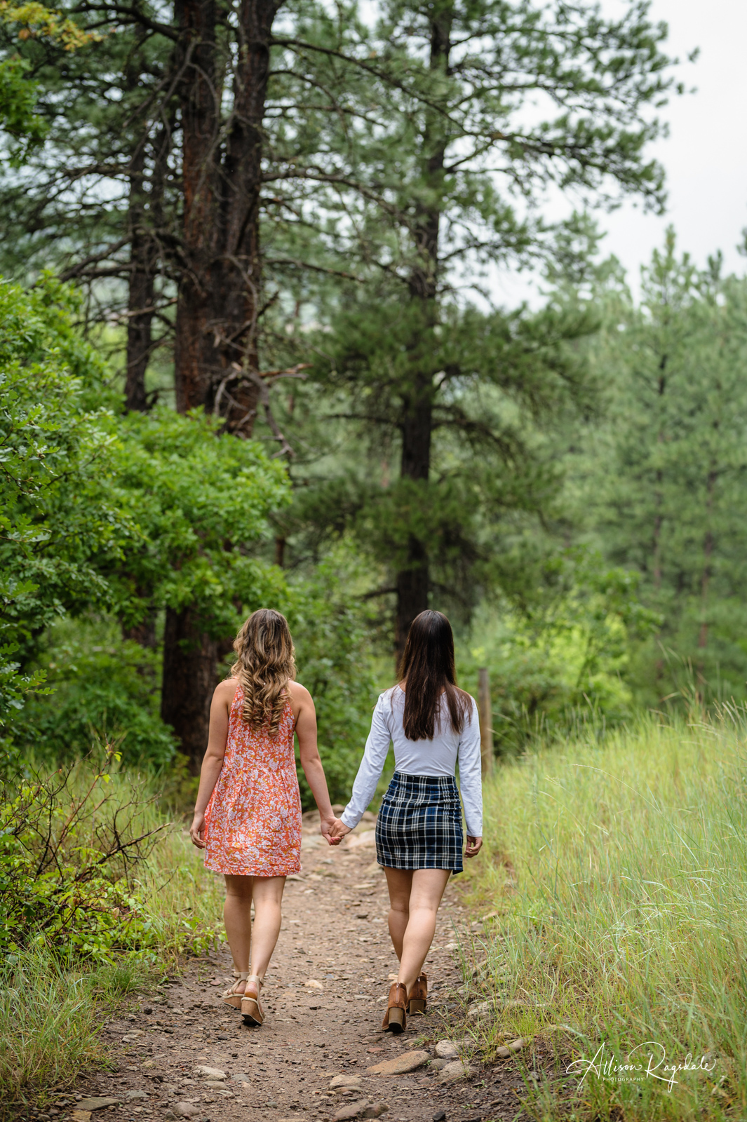 sisters walking down colorado trail picture