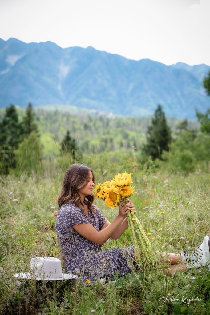 girl with sunflowers in mountains senior photo