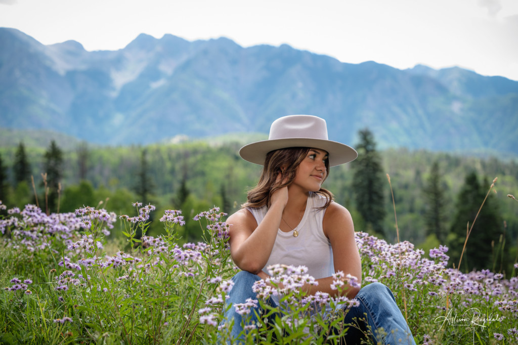 girl senior photo wildflowers in the mountains