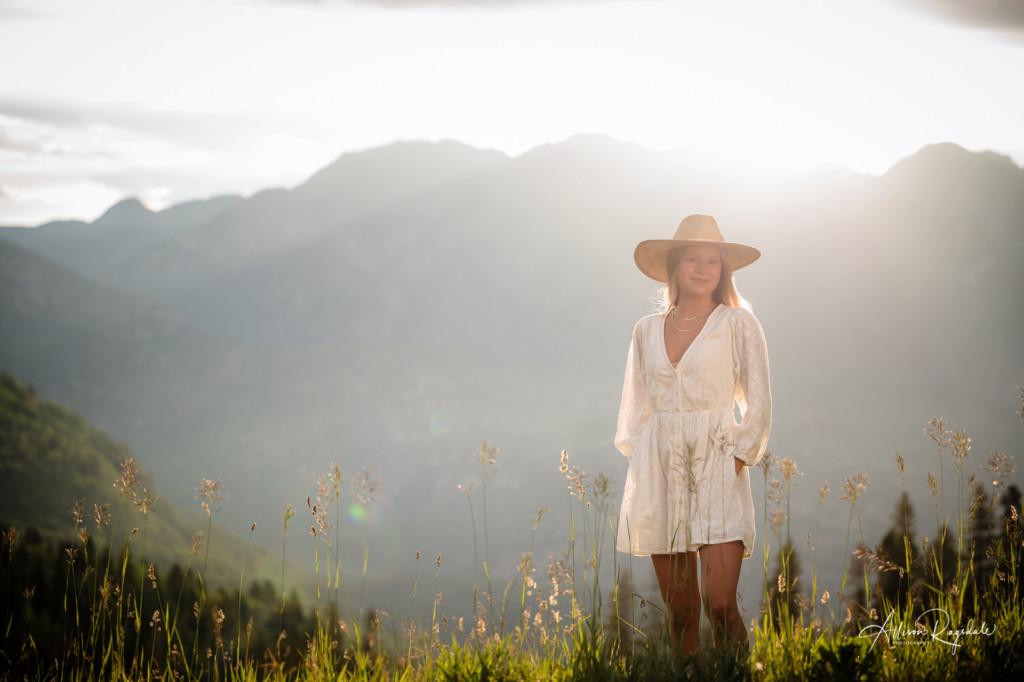 sunrise senior picture white dress straw hat mountains