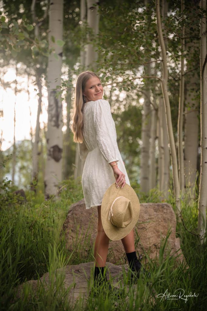 senior girl picture white dress straw hat aspen forest